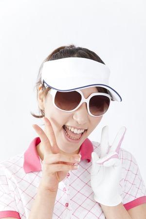 gratification: Women smiling and wearing sunglasses Stock Photo