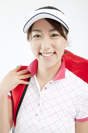 gratification: Woman smiles in golf style