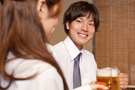 farewell party: Businessmen toasting with beer