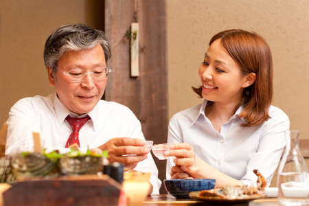 farewell party: Businessman to toast with cold sake Stock Photo