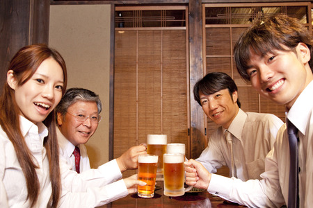 east end: Businessmen toasting with beer