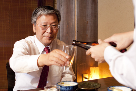 farewell party: and serving sake to get businessman
