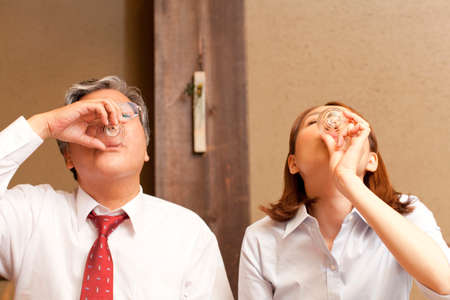 farewell party: Businessman drinking cold sake