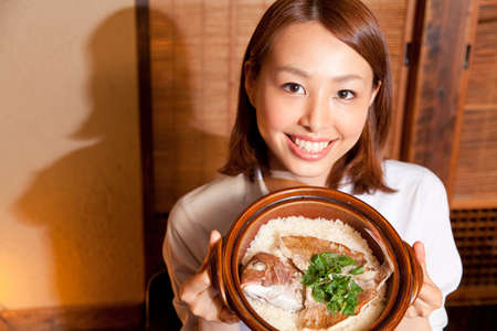 farewell party: OL smile with a sea bream rice