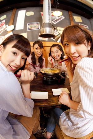 enclose: Women smile enclose the pot