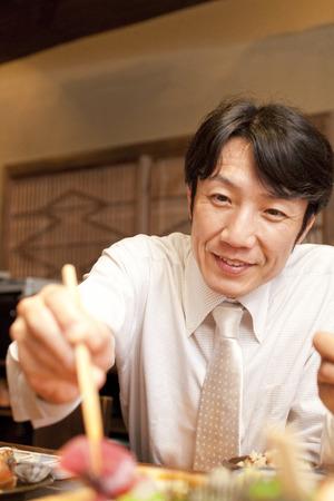 farewell party: Businessman eating cuisine