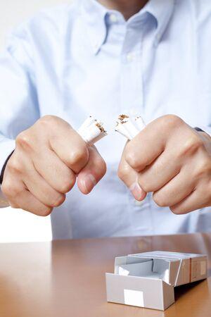 non  smoking: Fold the cigarette man Stock Photo