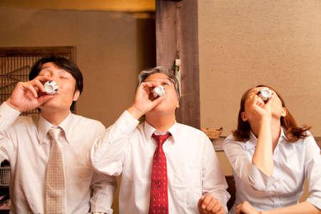alongside: Businessman drinking sake alongside
