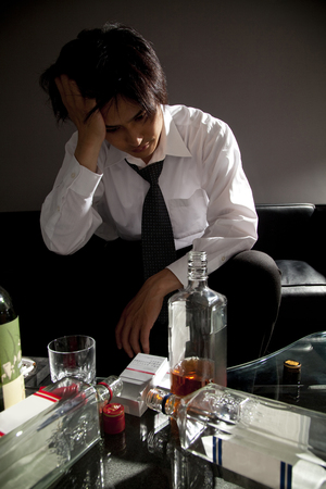 droop: Businessman to droop with a whiskey