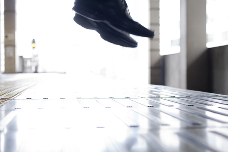 personal injury: Feet of businessmen jumping into the line Stock Photo