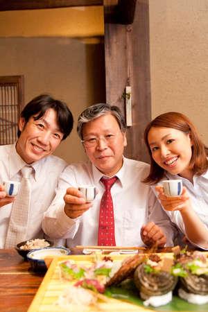 liquor girl: Businessman drinking sake alongside