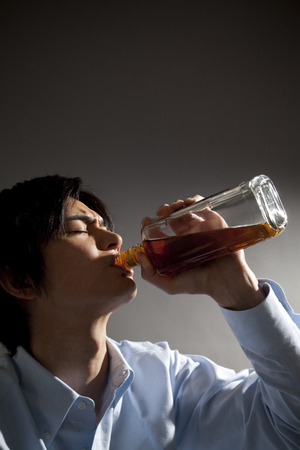 tiring: Men to out of the Whiskey bottle Stock Photo