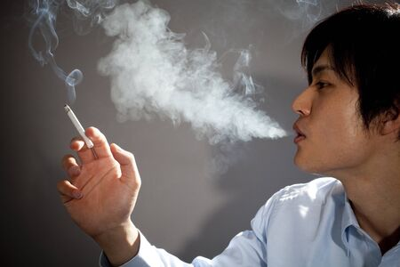 Businessman spit tobacco smoke