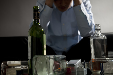 alcohol drinks: Man facing the head with a cup of sake