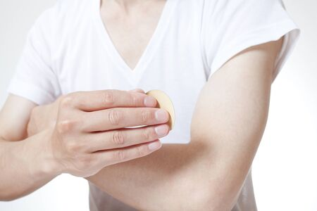 nicotine patch: Men put a smoking patch