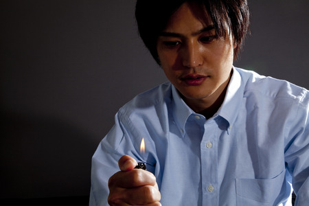 anguish: Men stare fire lighters