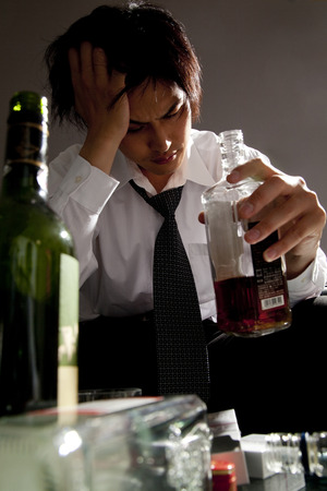 agonizing: Businessman drinking whiskey Stock Photo