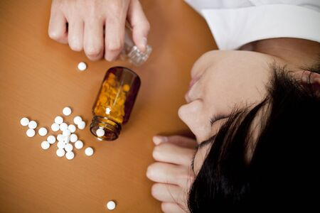 ingestion: Businessmen fall with a cup of sleeping pills