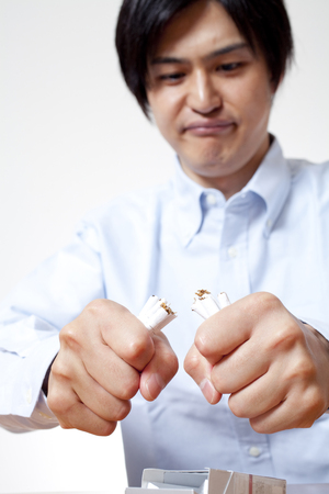 expressed: Fold the cigarette man Stock Photo