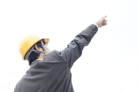 suffered: Businessman pointing the finger suffered a helmet Stock Photo
