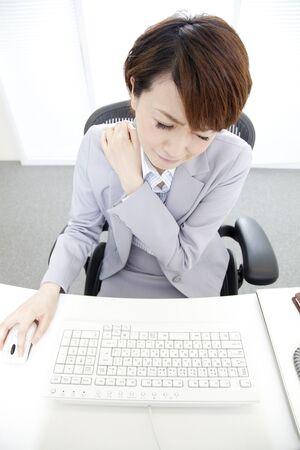 stiff: OL suffering from a stiff neck Stock Photo