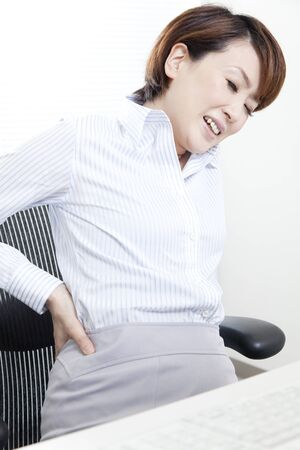 distort: OL to distort the face in low back pain Stock Photo