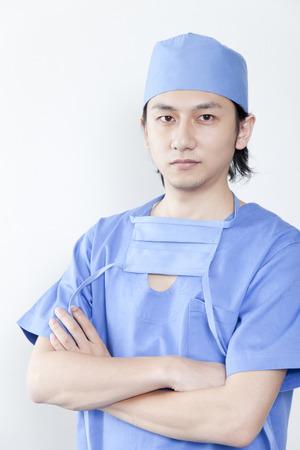 腕組み医師 写真素材