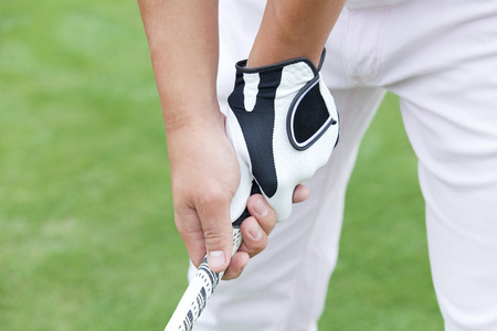 Hand of man holding the golf club