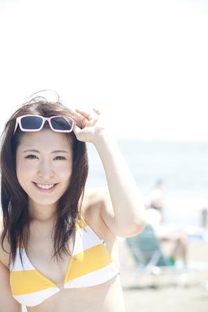 smiled: Women smiled on the beach. Stock Photo