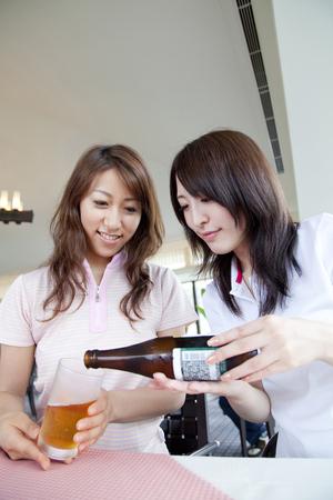 bottled beer: Woman pouring bottled beer