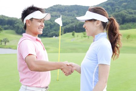 play date: Men and women shaking hands Stock Photo
