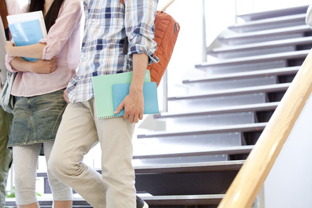 descend: College students descend the stairs Stock Photo