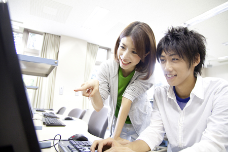 personal computer: College students who use the personal computer Stock Photo