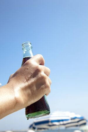 cola bottle: Hand of man with a Cola bottle