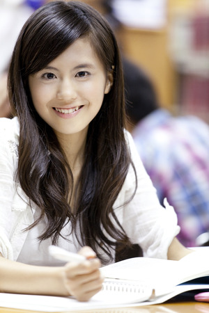 Smiling female university students Imagens