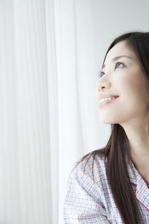 asian ancestry: Women stare out of the window Stock Photo