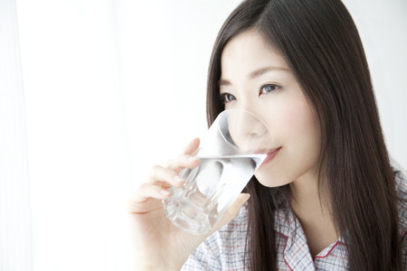 cup of water: Woman drinking water Stock Photo