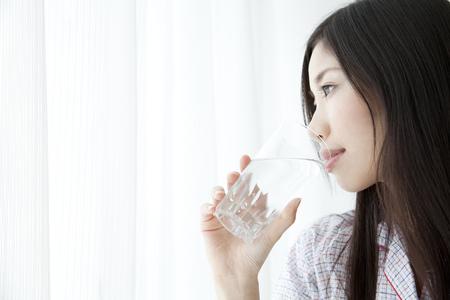 nightdress: Woman drinking water Stock Photo