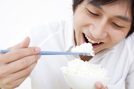 Men eat white rice Stock Photo