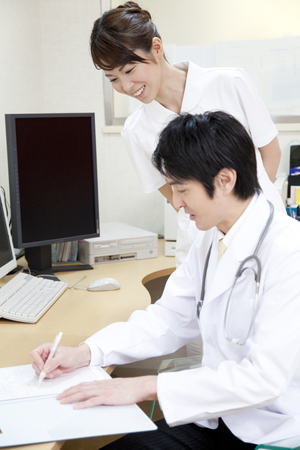nursing record: Doctors and nurses to write a medical record Stock Photo