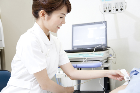 conduction: Nurse to check in nerve conduction velocity meter Stock Photo