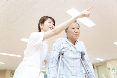 Trainer and patients to rehabilitation Stock Photo