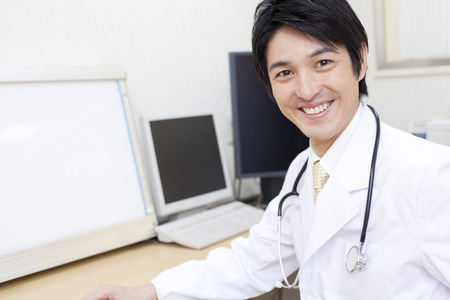 to be pleasant: Smiling doctor profile Stock Photo