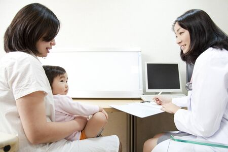 pediatra: entrevista al pediatra Foto de archivo
