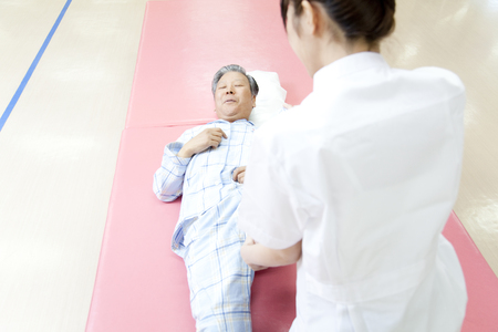 pliable: Rehab patients and trainer