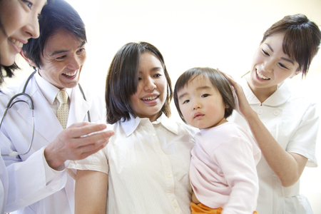 maternal: Hospital staff and maternal and child smile Stock Photo