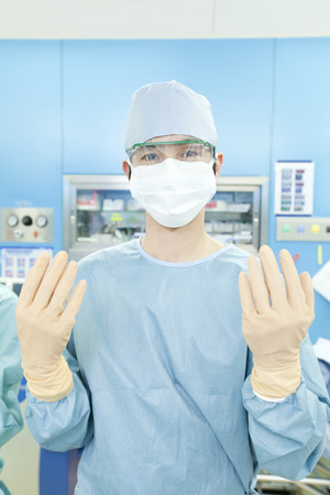 Surgeon to fit the rubber gloves