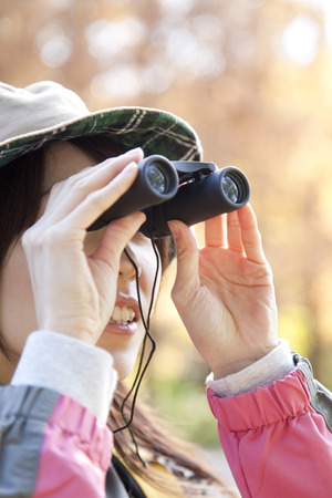 peer to peer: Women peer through binoculars