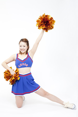 Cheerleader cheer with a smile Stock Photo