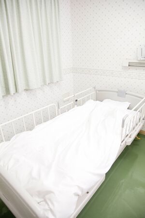 hospitalization: Hospital room bed Stock Photo